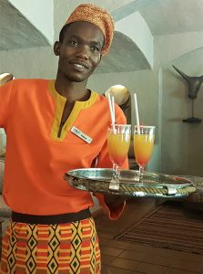 Welcome drinks by staff at Chobe Game Lodge
